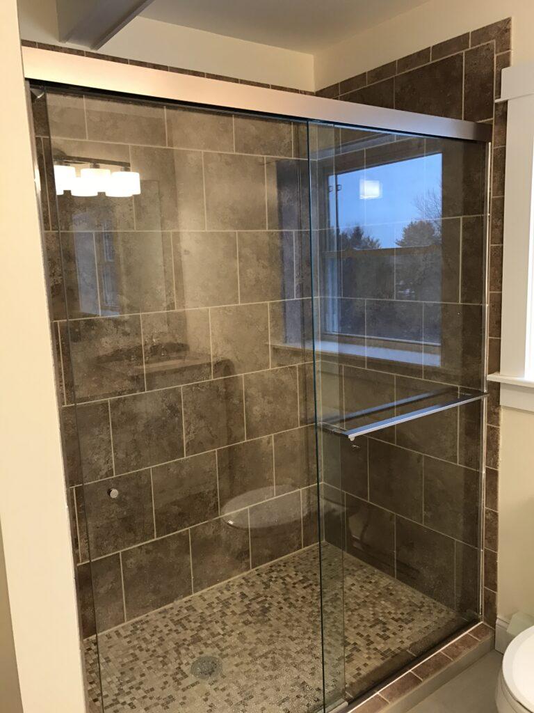 photo of custom tile shower with glass doors