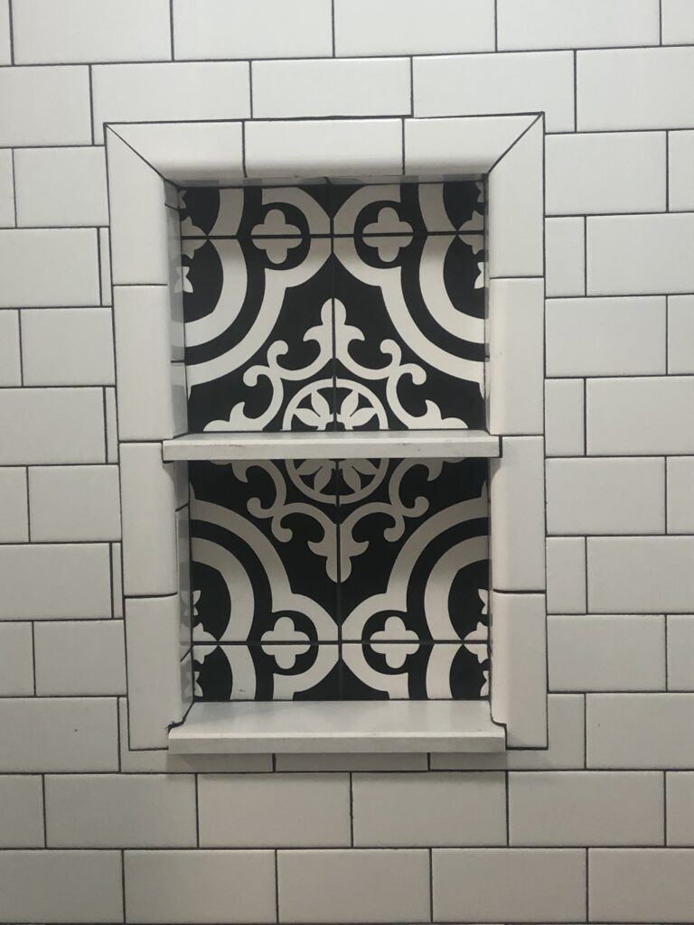 photo of custom tile work in shower wall