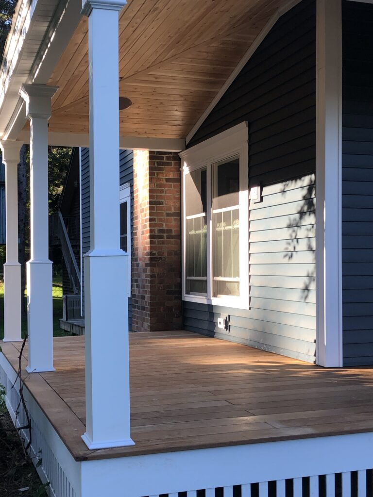 This porch floor is Brazilian walnut or IPE. They don't call it Iron wood for nothing.  So hard you can't drive a nail in it. If treated as directed it will out last pressure treated and is all natural an responsibly harvested.