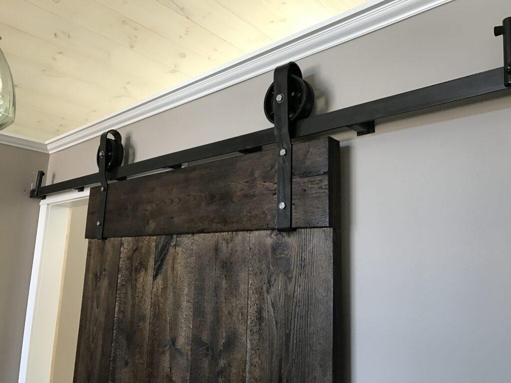Shop fabricated barn door and hardware, all locally made. Yep, We can weld too...