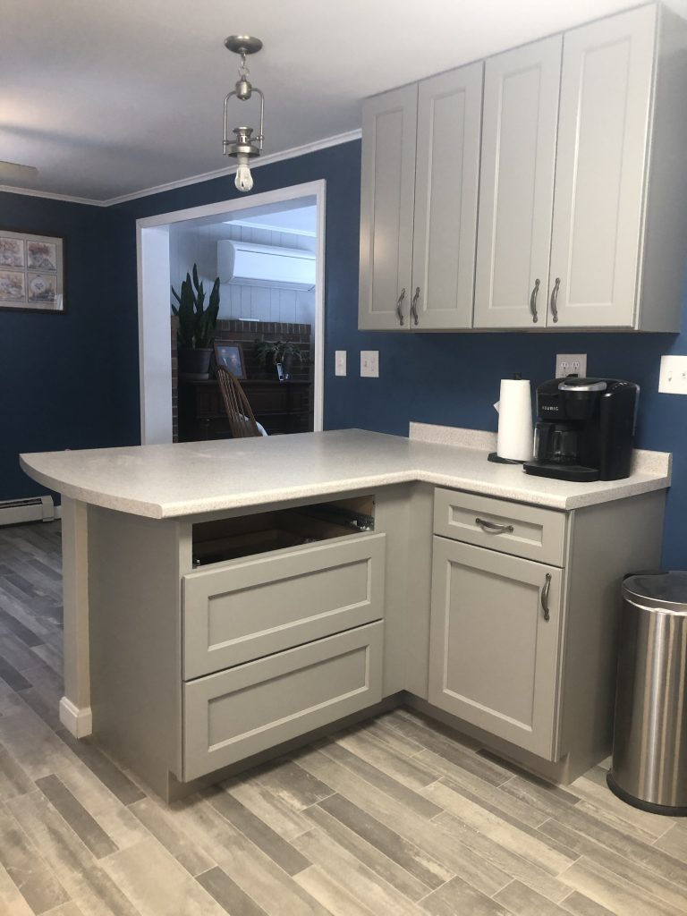 Gray painted cabinets, breakfast bar