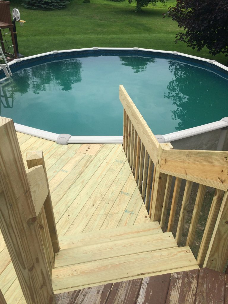Pressure treated, deck and rail going straight to the pool